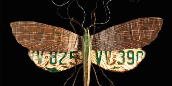 Repurposed metal and signage converted into insect art.